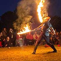Nighttime fire show with swords by Phoenix Swords